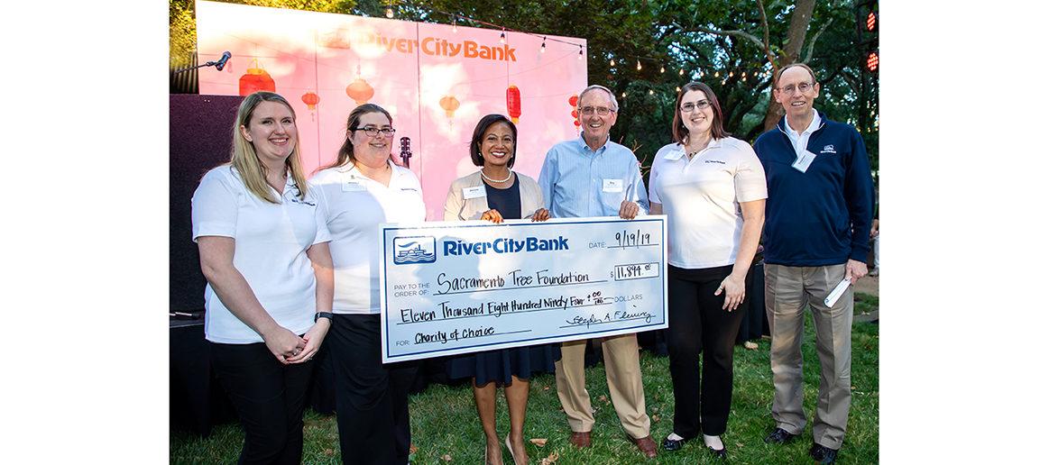 Photo of River City Bank presenting a check to the Sacramento Tree Foundation