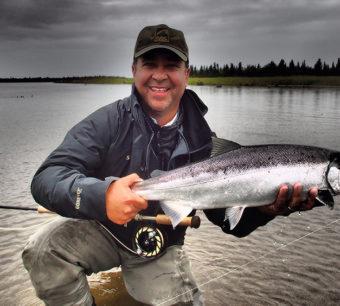 Jim Kimball catching salmon