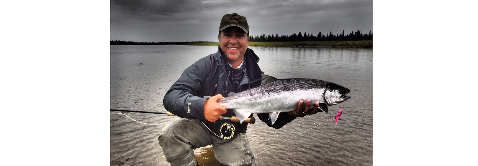 Jim Kimball catching salmon
