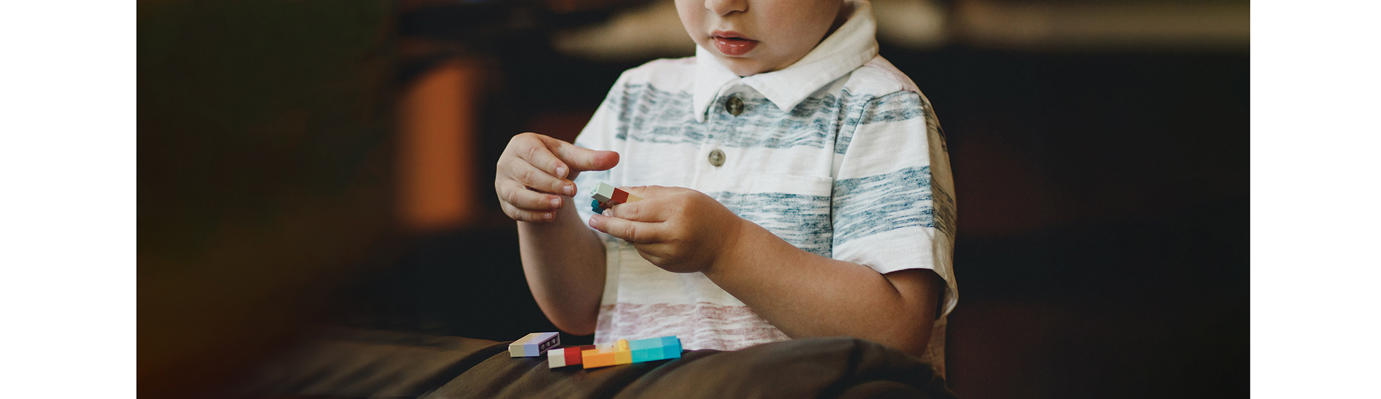Photo of child playing with blocks